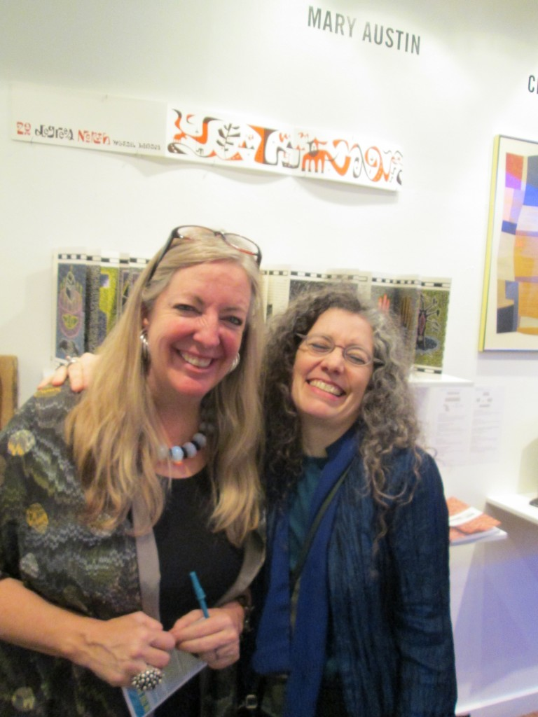 Mary Austin and Robbin Ami Silverberg in front of a selection from Mary's collection